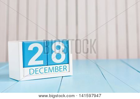 December 28th. Day 28 of month, calendar on wooden background. New year at work concept. Empty space for text.