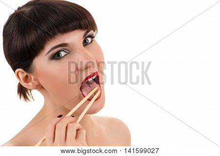 sexy woman licking chopsticks isolated on white