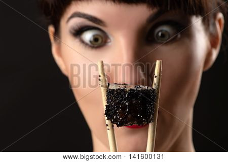 woman surprised looking on roll close up