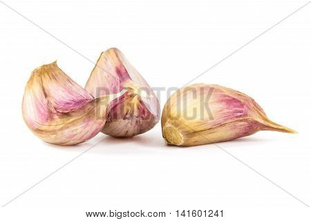 Garlic cloves isolated on white background, food.