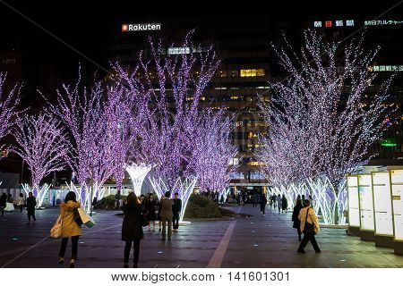 Fukuoka, Japan - March 21, 2016: Fukuoka on March 21, 2016. People are taking picture of holidays light decoration in Hakata Station.
