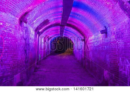 UTRECHT THE NETHERLANDS - JUNE 30: Purple and pink illuminated Ganzemarkt tunnel on June 30 2016 in the centre of Utrecht The Netherlands