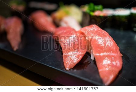 Maguro Sushi serve on Black plastic Tray