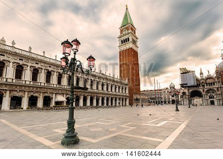 San Marco square with Campanile and Saint Mark's Basilica in sunrise. The main square of the old town. Venice, Italy.