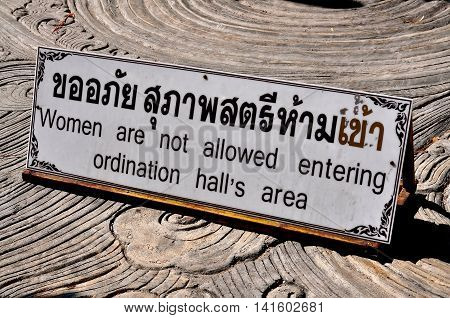 Chiang Mai Thailand - December 25 2012: Sign in Thai and English advises that women are not permitted to enter the ordination hall at Wat Sri Suphan