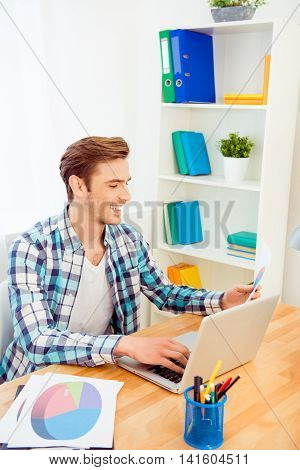 Portrait Of Happy Young Man Working With Laptop And Diagrama