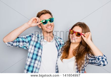 Portrait Of Happy Smiling Couple In Love Wearing Colored Spectacles
