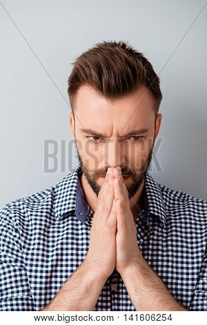 Portrait Of Young Concentrated Bearded Man  Praying And Waiting