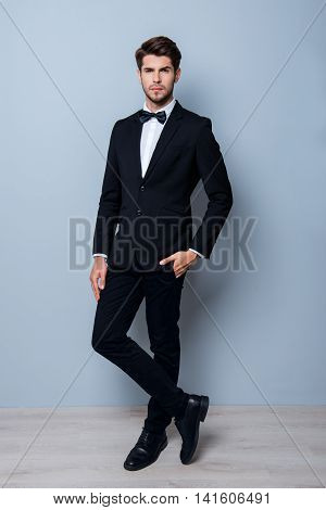Handsome Young Successful Businessman Posing In Black Suit