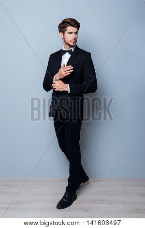 Young Handsome Groom In Black  Suit Fastening Buttons On The Sleeves