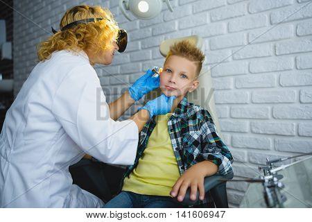 Ent doctor or Otolaryngologist examining a kid ear.