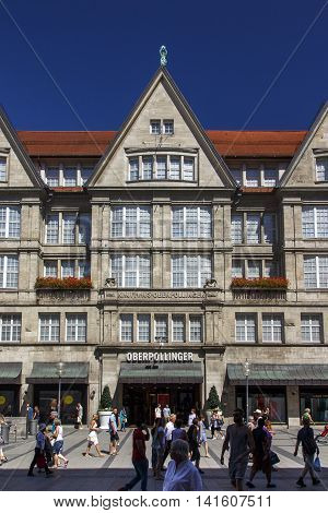 MUNICH, GERMANY - AUGUST 29, 2015: The Oberpollinger is a famous shopping mall in the inner city of Munich many luxary brands have retail stores inside unidentified people are passing by