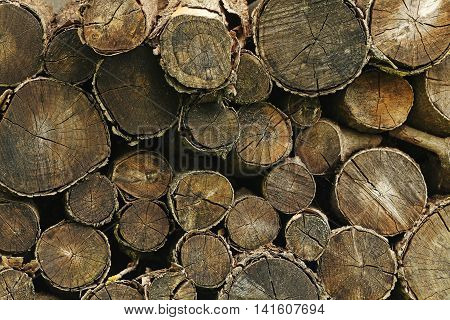Pile of the firewood logs background, close up