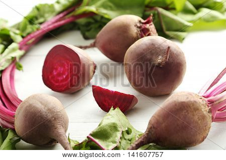 Fresh Beets On A White Wooden Table