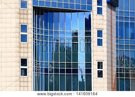 Wall of large high-tech style building with large glass windows