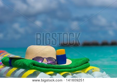 Sunglasses And Straw Hat On A Air Mattress In Sea. Tropical Summer Concept.