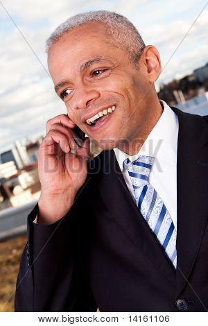 Businessman talking on cellphone outside