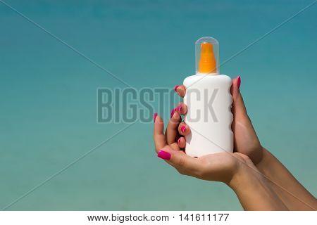 Woman Hands Putting Sunscreen From A Suncream Bottle