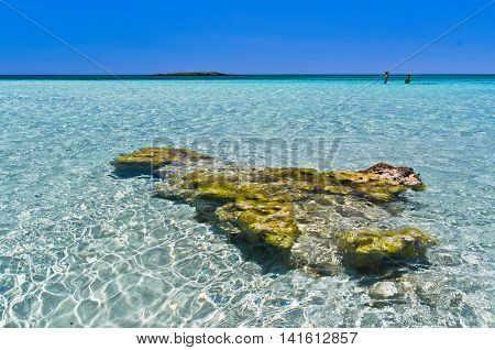 Amazing beauty of shallow crystal clear waters at Elafonisi beach, island of Crete, Greece