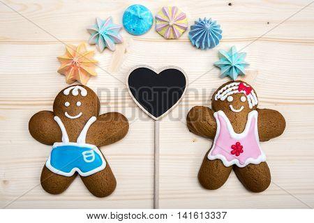 Homemade gingerbread cookies over wooden table. meringue