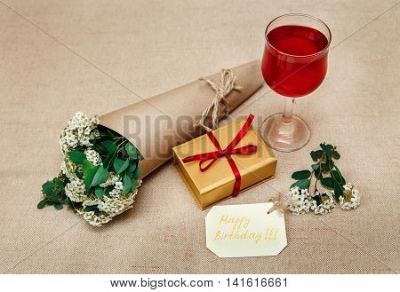 Romantic Breakfast.Cup of Coffee.Glass of Red Drink.Wish Card with Flowers.Present in Golden Box with Red Ribbon
