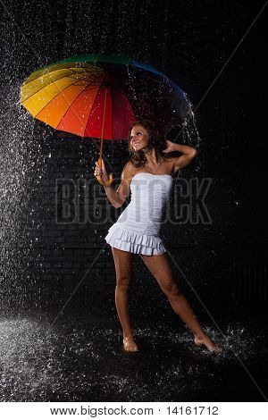 Young Woman With Multi-coloured Umbrella.