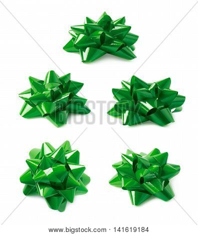 Decorational green ribbon gift bow isolated over the white background, set collection of five diffirent foreshortenings