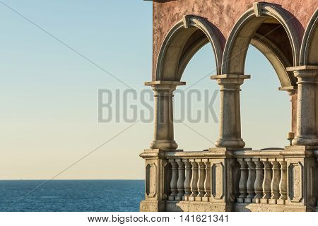 Italian mansion with columns on balcony and as beach house with pacific ocean view