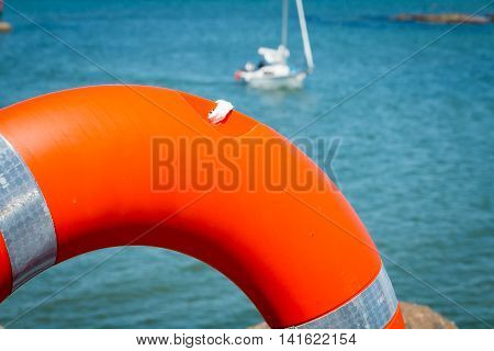 Noirmoutier France - April 28 2016 : lifebuoy on the sea with a boat