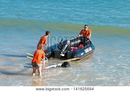 Rench Bay Lifeguards With Their Boat