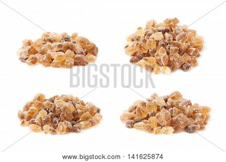 Pile of brown rock sugar crystals isolated over the white background, set of four different foreshortenings