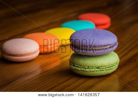 Image of assorted macaroons on a wooden table