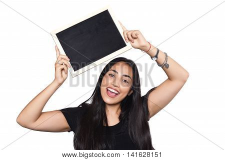 Portrait of latin woman holding chalkboard. Isolated white background.