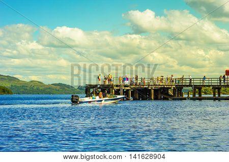 People on a tour motor boat at Loch Lomond in Luss Scotland,  21 July 2016