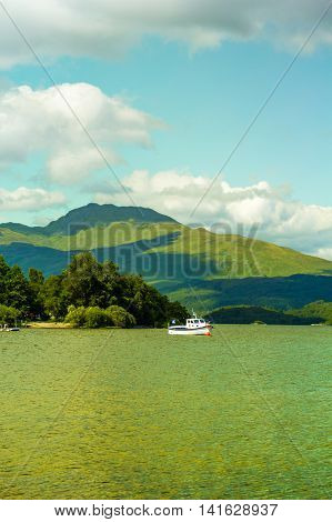 Boat on a sunny day at Loch Lomond lake in Scotland UK