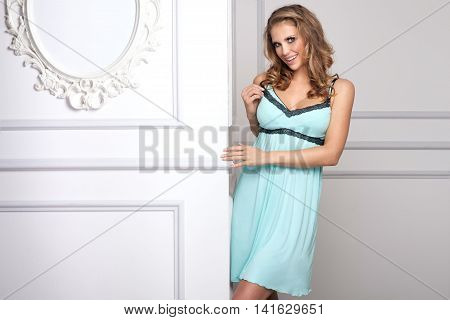 Sexy Girl With Blonde Hair Posing In Nightwear.