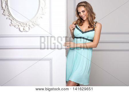 Sexy Girl With Blonde Hair Posing In Nightwear.