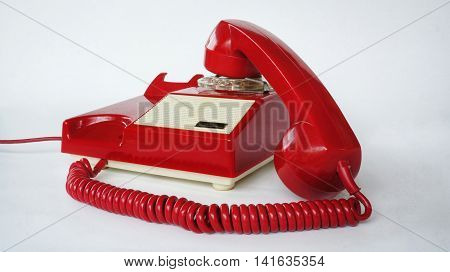 Red phone with earpiece not hung up
