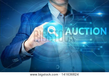 Business, Internet, Technology Concept.businessman Chooses Auction Button On A Touch Screen Interfac