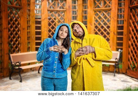 Pensive couple wearing pijamas