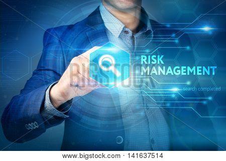 Business, Internet, Technology Concept.businessman Chooses Risk Management Button On A Touch Screen
