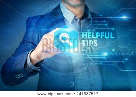 Business, Internet, Technology Concept.businessman Chooses Helpful Tips Button On A Touch Screen Int