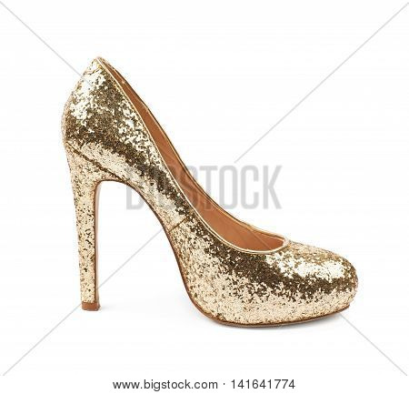 Shining golden high-heeled footwear shoe isolated over the white background