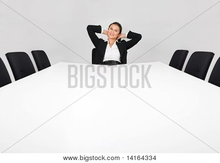 Businesswoman sitting alone