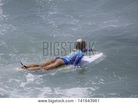 Tatiana Weston- Webb competing in the July  2016, Vans US Open of Surfing, Huntington Beach CA.