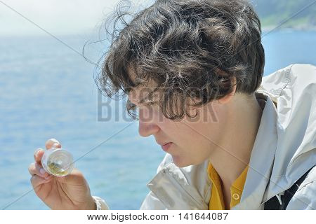 The young woman entomologist at sea. Russian Far-East.