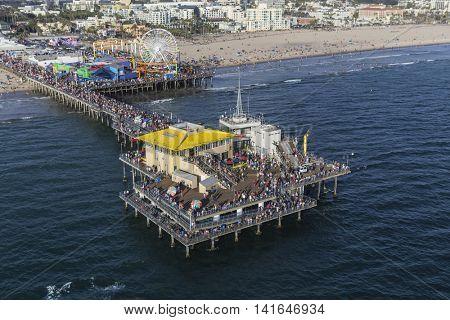 Santa Monica, California, USA - August 6, 2016:  Aerial of summer weekend crowds on popular Santa Monica Pier near Los Angeles.