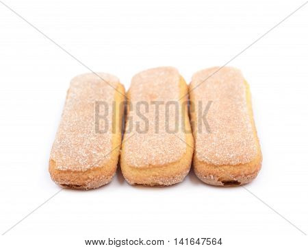 Ladyfinger savoiardi biscuit cookies lined up, composition isolated over the white background