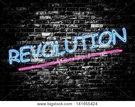 Revolution sign on old black vintage brick wall background
