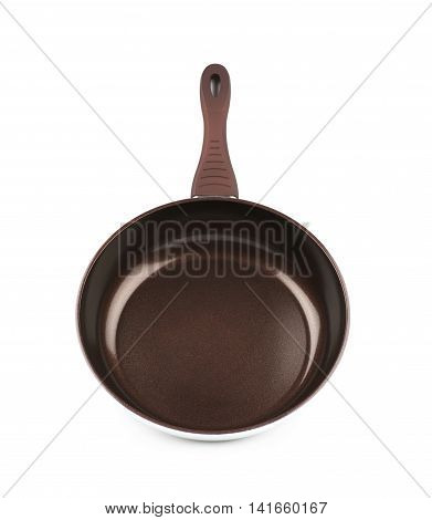 Brand new brown frying pan with a teflon coating, composition isolated over the white background